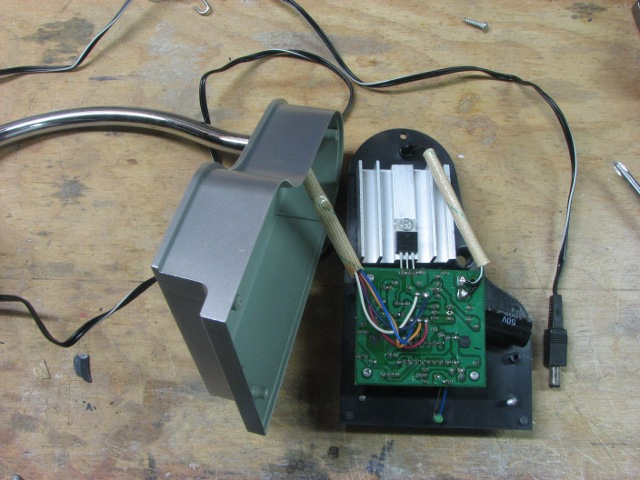Picture showing the base of the globe removed, with circuit board, heat sink, and connection to the arm.