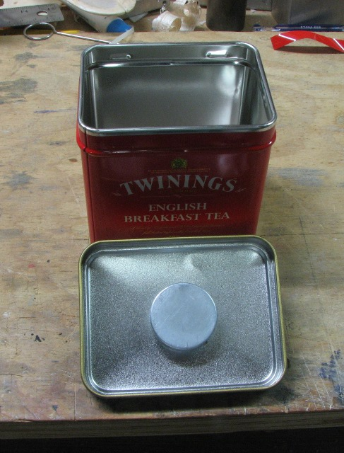 Tea tin showing magnet installation